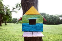 Colorful bird house. On the tree royalty free stock images