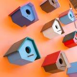 Colorful bird nest wood box decorated on orange wall Royalty Free Stock Image
