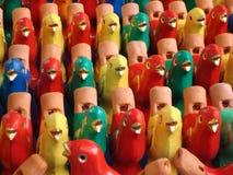 Colorful bird statues pattern. Beautiful pattern created from colorful bird statues royalty free stock photos