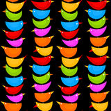 Colorful bird totem seamless background. Colored birds in top of each other making a row. Black seamless background Stock Photo