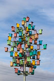 Colorful birdhouses on a background of blue sky Royalty Free Stock Photo