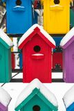 Colorful birdhouses for the birds in snow.  Royalty Free Stock Photos