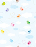 Colorful birds in the sky. Colorful birds and clouds seamless pattern for kids stock illustration