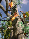 Colorful birds at a theme park in Thailand. Colorful real-like birds featured at an amusement park, near Bangkok, Thailand Stock Images