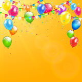 Colorful birthday balloons and pennants on orange background. Flying colorful balloons, multicolored pennants and confetti on orange background with sunlight Stock Photo