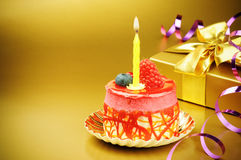 Colorful birthday cake with candle Stock Photo