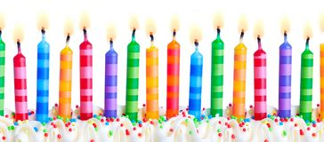 Colorful birthday cake candles royalty free stock photography