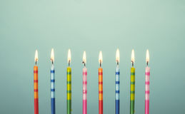Colorful birthday cake candles Stock Photography