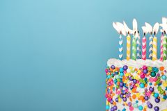 Colorful birthday cake with lots of candles stock image