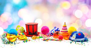 Colorful birthday or carnival background with party items isolated on white royalty free stock photos