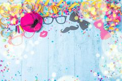 Colorful birthday or carnival frame with party items on wooden background. royalty free stock photo