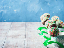 Colorful birthday chocolate cake pops on wooden background Royalty Free Stock Photography