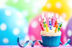 Colorful birthday cupcake stock photography