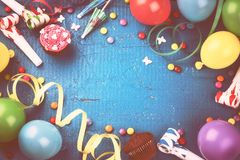 Colorful birthday frame with multicolor balloons and party items Stock Photography