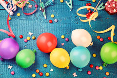 Colorful birthday frame with multicolor party items on dark blue royalty free stock images