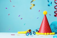 Colorful birthday party hat and streamers Royalty Free Stock Images