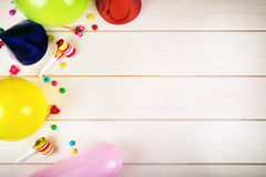 Colorful birthday party items with copy space. top view royalty free stock image