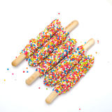 Colorful biscuit stick coated enamel rainbow sugar texture background. Colorful biscuit stick coated enamel rainbow sugar with white space background for writing Stock Image