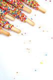Colorful biscuit stick coated enamel rainbow sugar with white space background. For writing wording Royalty Free Stock Photography