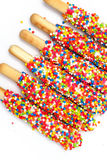 Colorful biscuit stick coated enamel rainbow sugar with white space background. For writing wording Stock Image