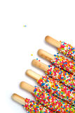 Colorful biscuit stick coated enamel rainbow sugar with white space background. For writing wording Royalty Free Stock Image