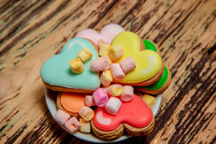 Colorful biscuits and sweets on wood Stock Photography