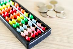 Colorful black Chinese abacus. royalty free stock photography