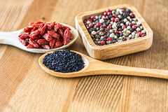 Colorful Black Pepper, Raisin and Black Cumin Stock Images