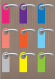 Colorful blank door hangers on door knobs Stock Photos