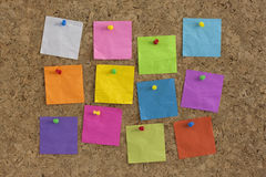 Colorful blank notes on cork board Royalty Free Stock Image