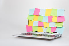 Colorful blank paper memos stuck to a laptop Stock Photos