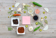 Colorful blank stickers for notes and pepper, bay leaf, rosemary, onions, Himalayan salt, olive oil, soy sauce on Stock Photos
