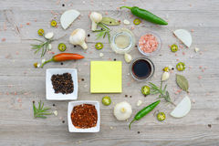 Colorful blank stickers for notes and pepper, bay leaf, rosemary, onions, Himalayan salt, olive oil, soy sauce on Royalty Free Stock Image