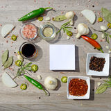 Colorful blank stickers for notes and pepper, bay leaf, rosemary, onions, salt, olive oil Stock Images