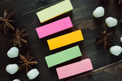 Colorful blank stickers on the wooden table Stock Image
