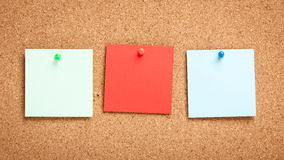 Colorful blank sticky notes on corkboard Royalty Free Stock Image