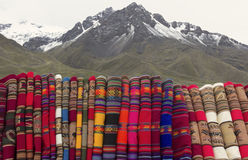 Colorful blankets sold on Abra la Raya. Handmade and colorful Peruvian blankets sold on Abra la Raya between Cusco and Puno stock photos