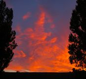 Colorful, blazing sunset, hot clouds royalty free stock photos