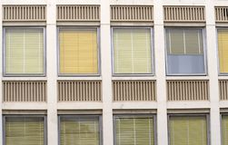 Colorful blinds (3079). Blinds of different colors in a series of windows from the outside of a modern building Royalty Free Stock Image