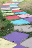 Colorful block walkway in the garden. Garden paths act as the backbone of landscape design, providing a sense of structure and order royalty free stock photo