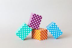 Colorful blocks polka dot pattern. Violet green orange blue color rectangular abstract boxes arranged on gray background royalty free stock photos