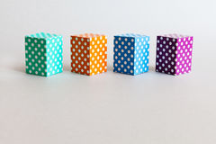 Colorful blocks polka dot pattern. Violet green orange blue color rectangular abstract boxes arranged on gray background Stock Photo