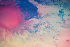 Colorful blots on white paper close up. Abstract background royalty free stock image