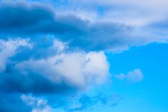 Colorful blue background with clouds stock image