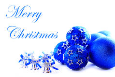 Colorful blue christmas decoration baubles. On white with space for text Royalty Free Stock Images