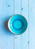Colorful Blue dish over a light blue painted wood table Stock Photos