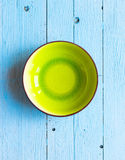 Colorful Blue dish over a light blue painted wood table Royalty Free Stock Photography