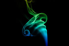 Colorful blue and green smoke Royalty Free Stock Photography