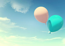 Colorful blue and pink balloons floating in summer holidays in pastel color filter, concept of summer, holidays, and joyful. Pastel blue and pink color also Royalty Free Stock Photos