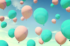 Colorful blue and pink balloons floating in summer holidays in pastel color filter, concept of summer, holidays, and joyful. Pastel blue and pink color also Stock Photos